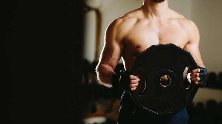 Plate Raises for Shoulders: How To Do & Muscles Worked